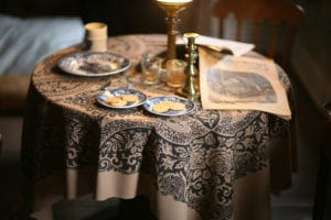 American Civil War newspaper rests on a table set with coffee and cookies