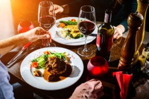 Couple Having Romantic Dinner in sunny restaurants in independence